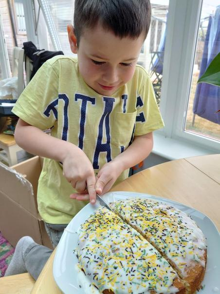 2SK Seth P made and cut up his 'fractions' cake.jpg