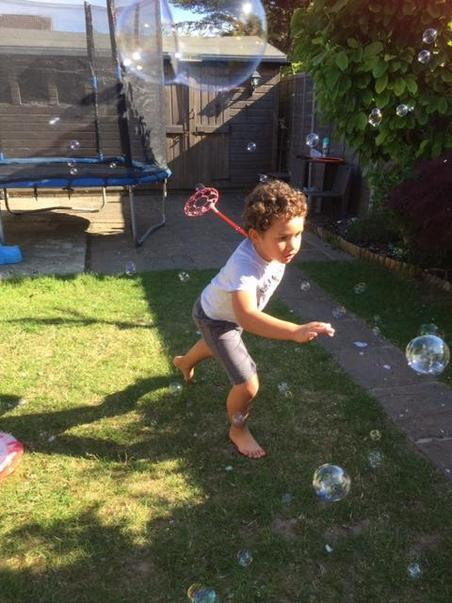 2MT Noah T having fun with bubbles.jpg