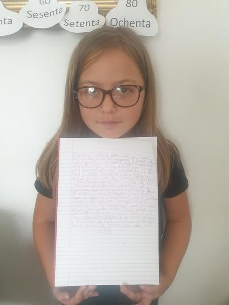 Year 3 Eliza MM with her piece of story writing.jpg
