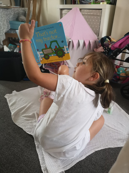 1RN Lottie A Reading to her baby after school.png