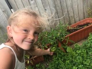 RLH Jenna growing her own tomatoes.jpg