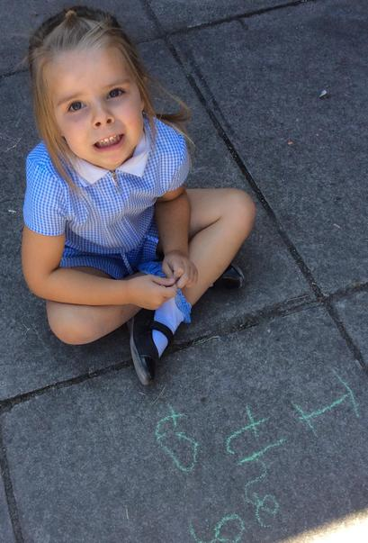 RAN - Evie M practised writing some of her tricky words in chalk.JPG
