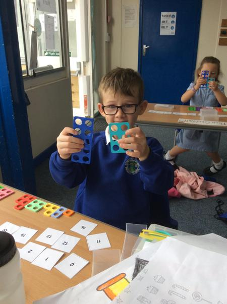 RMS Franky W making teen numbers using numicon.JPG