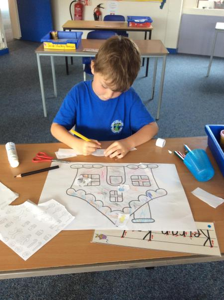 RMS Keiran K colouring and collaging his 'Hansel and Gretel' gingerbread house.JPG