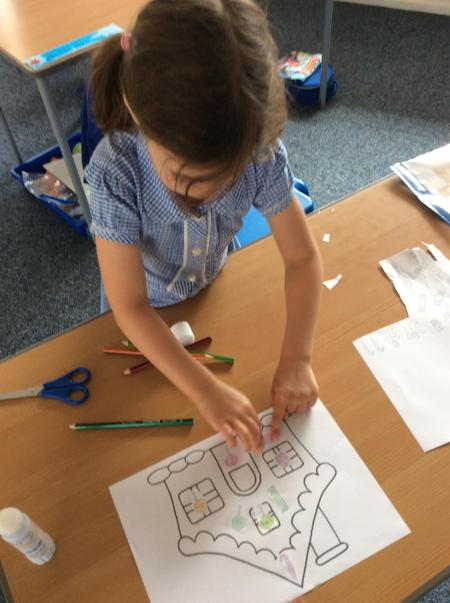 RAN - Ellia R - collaging a sweetie house with sweets she has coloured and cut out..JPG