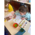 Class 4 had a go at colour washing their self portraits in the style of Picasso.