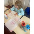 Children looked at how to make one colour lighter and darker by adding water