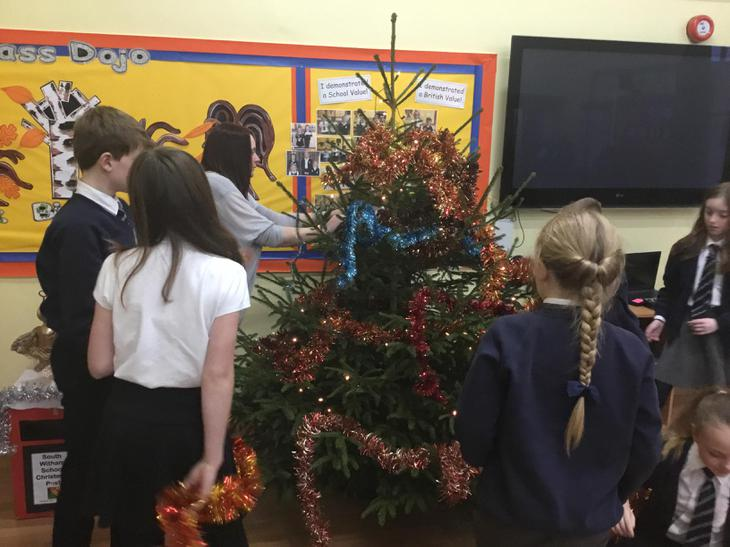 Year 6 children helped to decorate the tree!