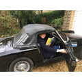 Mrs Walker read in a very cool parked car!