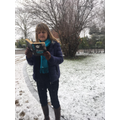 Mrs Costello reading in the snow!
