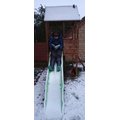 Taylor completing some extreme reading in the snow on a slide!