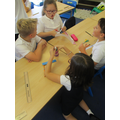 Working together to create a rocket prototype.