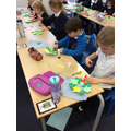 We used our knowledge of shapes in maths to create a wreath for our advent countdown.