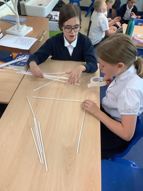 Grace and Rosey building a bridge