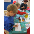 Using water colours to paint our characters