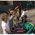 Miss Shaw and some Year 1s come to say thank you
