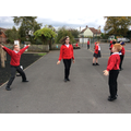The children are practising their routine.