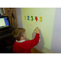 Writing numbers on the interactive whiteboard