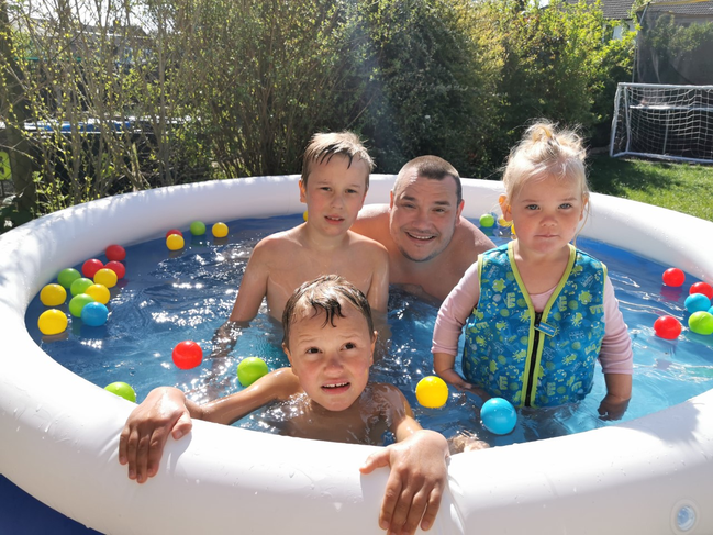 Charlie and his family having fun in the pool