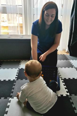 Jackie playing a game with little Roco