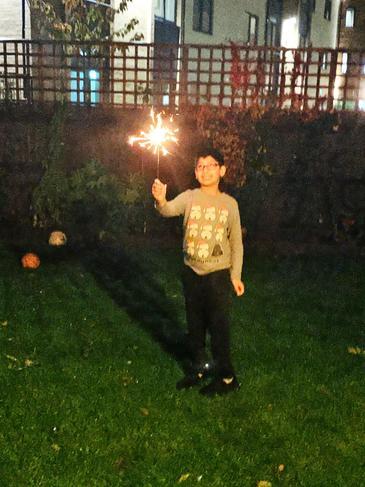 Ali enjoying a sparkler in the garden.