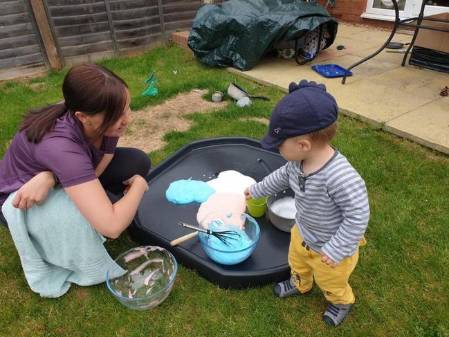 Sarah and Thomas making blue and white foam
