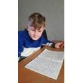 Lewis practising his spellings