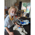 Dr Erin careing for her poorly teddy