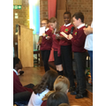 Year 6 pupils reading poems aloud