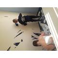 Callum stripping wallpaper