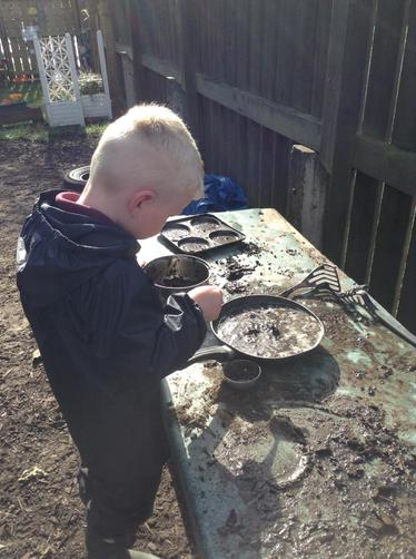 in the mud kitchen...