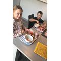 Layla-Grace and Corey making a fruit salad