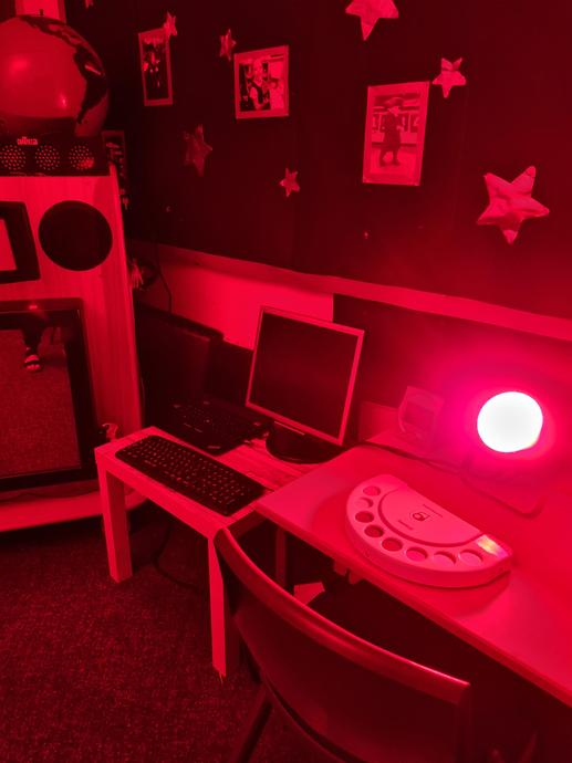 [Picture of bright red light and switch panel.]