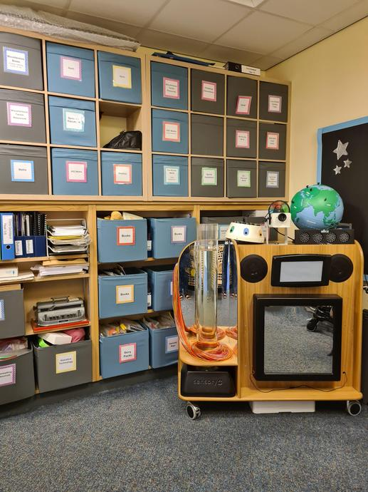 [Picture of the Light Room including light stimulation equipment and boxes of resources.]