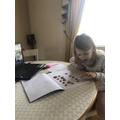 Sienna hard at work on her maths