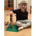 Freddie building at home with his lego.