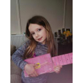 Chloe made a guitar from recylced boxes