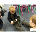Comparing the length of our feet.