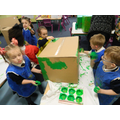 team work to paint the dinosaur body