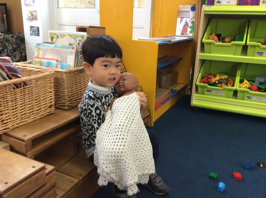 Looking after our babies in the role-play area!