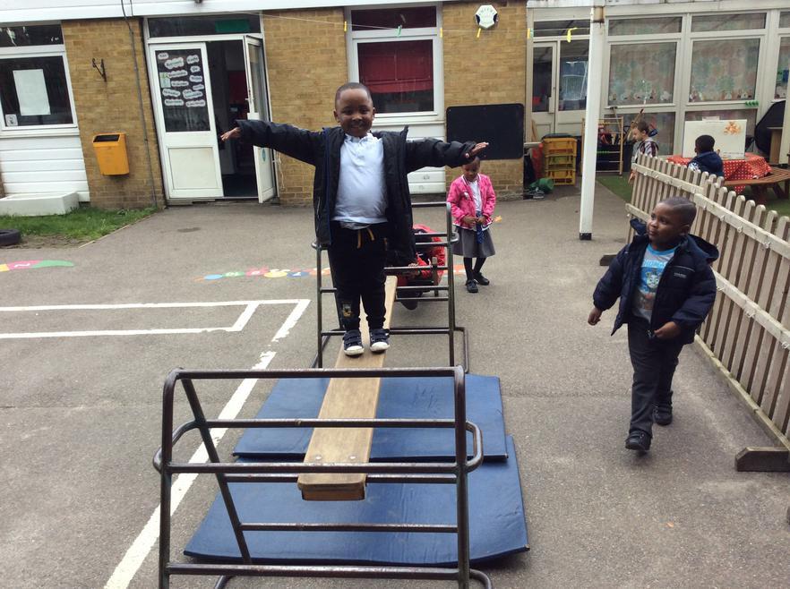 We practise balancing on the climbing apparatus