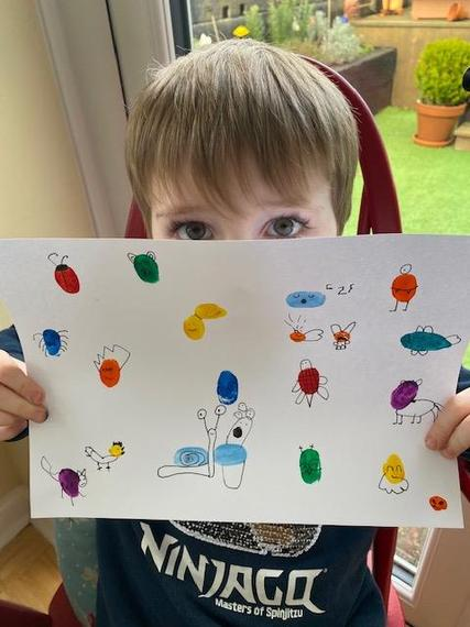 Thomas and his finger painting artwork