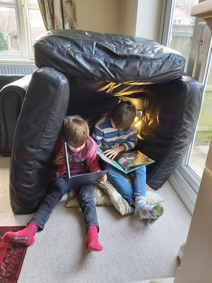 Adam and Ewan reading in their den