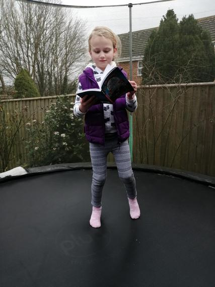 Alice bouncing and reading at the same time