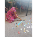 Thenuki doing a jigsaw puzzle