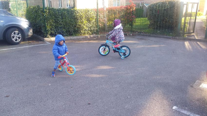 Crown and Queen-Esther on their bikes!