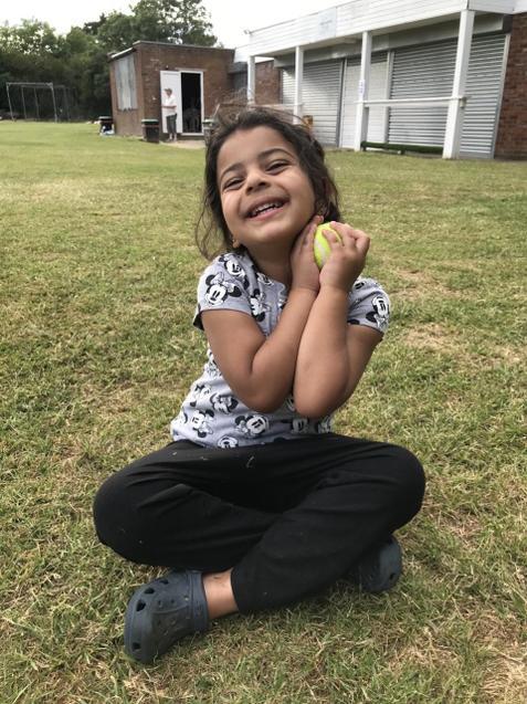 Amaya having fun playing outside.