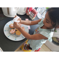 Sanuli icing some cakes...yummy