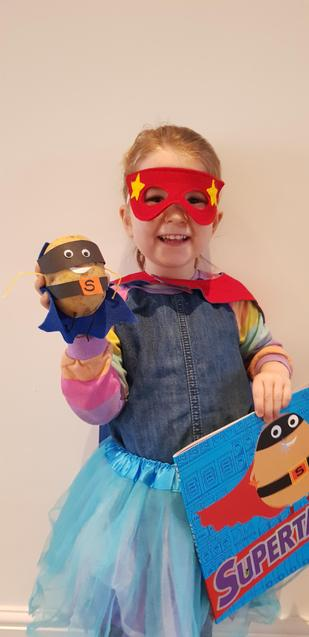 Elodie dressed up as Supertato