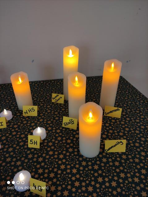 A candle is lit for the wider community